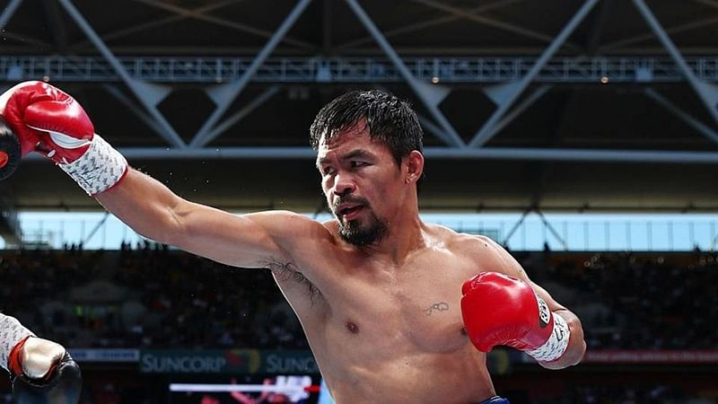Boxer Manny Pacquiao challenges Floyd Mayweather for a rematch
