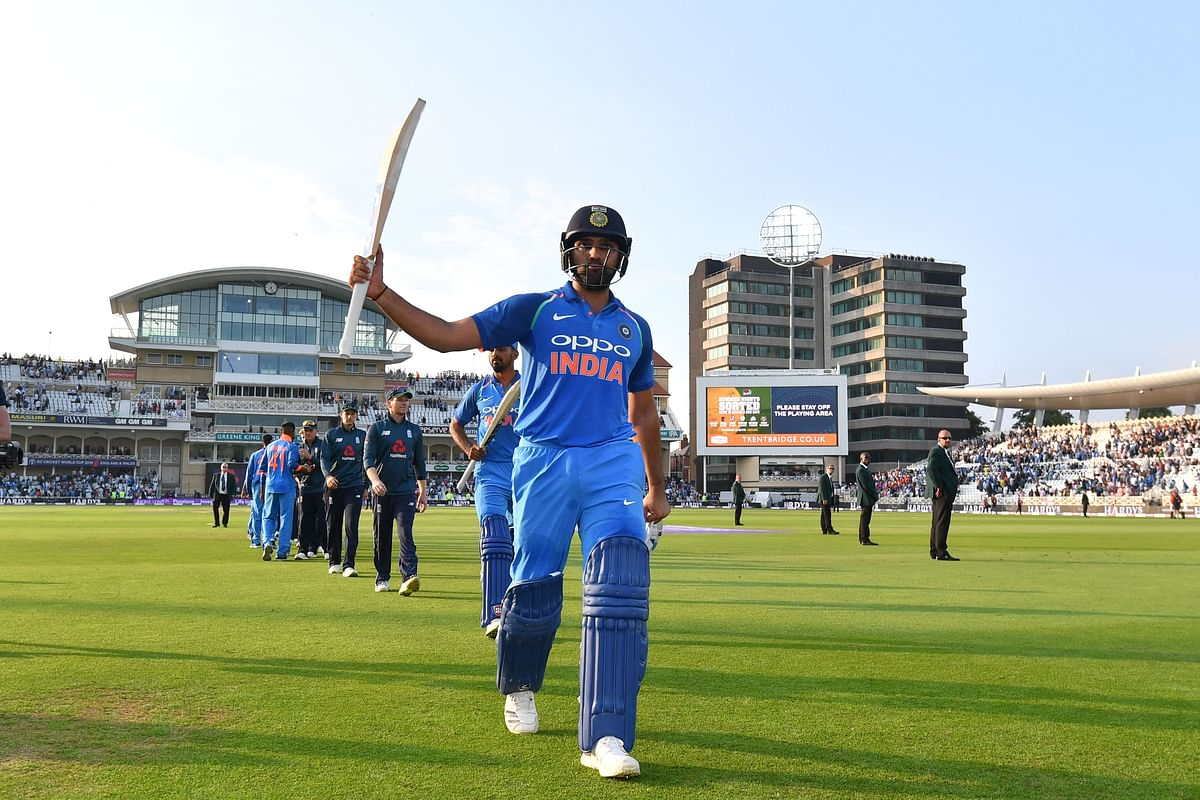 India's Rohit Sharma raises his bat to acknowledge the crowd as he leaves the field after India won the One Day International (ODI) cricket match between England and India at Trent Bridge in Nottingham central England on July 12, 2018. / AFP PHOTO / Anthony Devlin