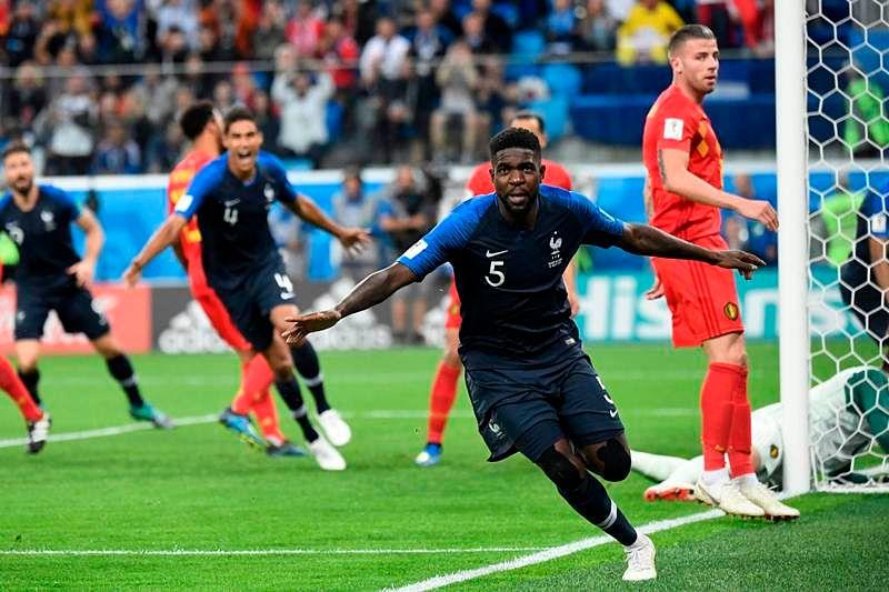 France's defender Samuel Umtiti celebrates scoring the opening goal