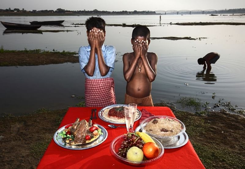 Poverty Porn? Italian photographer slammed for 'insensitive' depiction of hunger in India