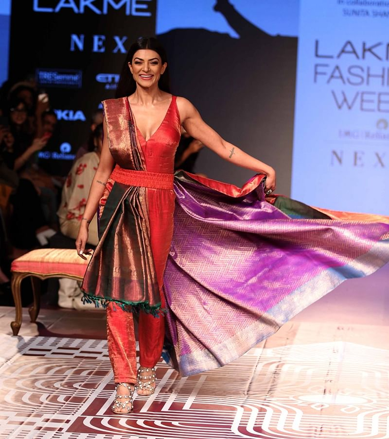 Mumbai: Bollywood actress Sushmita Sen walk ramp for RMKV Silks Re-Crafting traditional silks in collaboration with fashion designer Sunita Shankar during Lakme Fashion Week Winter/Festive 2018 in Mumbai on Thursday. Photo by BL SONI