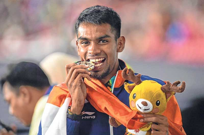 <em><strong>Dharun celebrates after winning silver medal in the 400m Hurdles</strong></em>