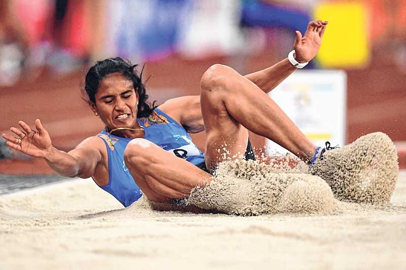 <em><strong>India's Neena Varakil competes in the final of the long jump event</strong></em>