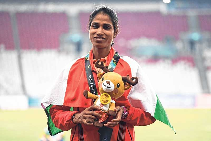 India's Sudha Singh poses after winning silver medal in the women's 3000m steeplechase event in Jakarta on Monday.