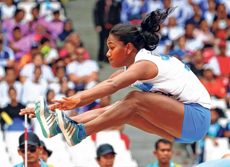 <strong>India's Swapna Barman competes in the heptathlon long jump during the Asian Games on Wednesday</strong>