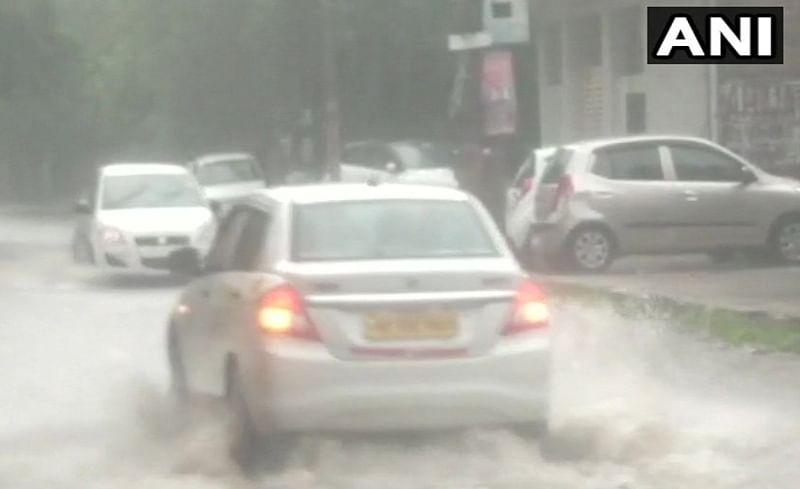 See Pics: Heavy rains lash Gurugram, Delhi; Streets waterlogged, traffic jam hits normal life