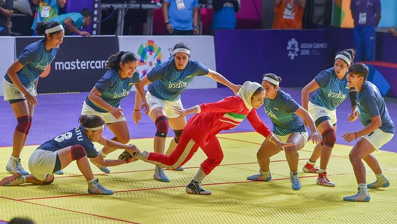 Indian women's kabaddi team members tackle down an Iranian raider in the finals at the Asian Games 2018, in Jakarta. PTI Photo/Shahbaz Khan