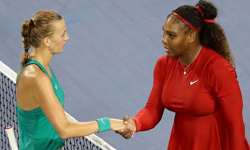 Petra Kvitova shakes hands with Serena Williams after defeating her in three sets during Day 4 of the Western and Southern Open.   Rob Carr/Getty Images/AFP