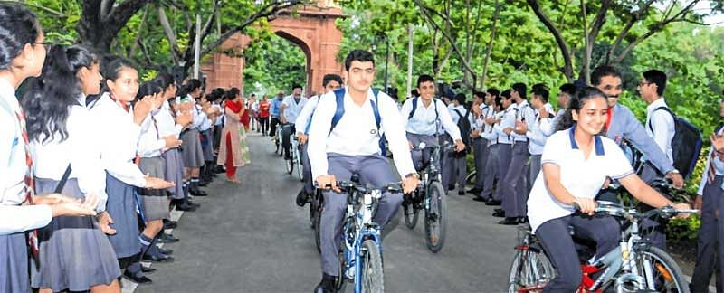 Daly College staff, students get on bikes to promote environment protection