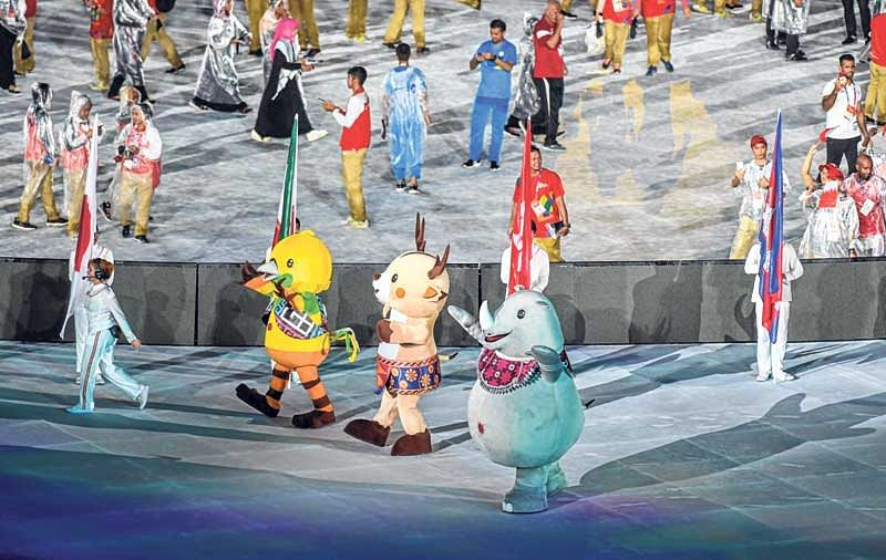 <em><strong>Official Games' mascots Bhin Bhin, Ika and Atung march during the closing ceremony in Jakarta on Sunday</strong></em>
