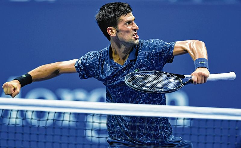 Novak Djokovic crushes John Isner in straight sets in ATP Finals opener