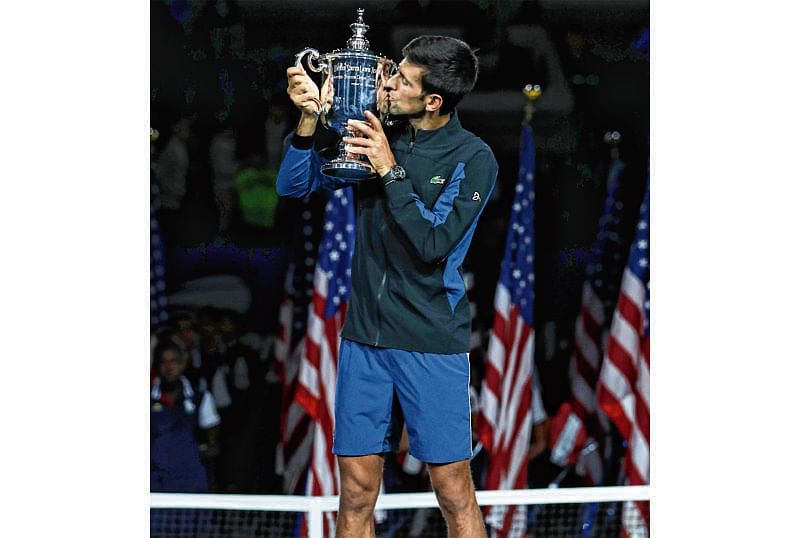 NEW YORK, NY - SEPTEMBER 09: Novak Djokovic of Serbia poses with the championship trophy after winning his men's Singles finals match against Juan Martin del Potro of Argentina on Day Fourteen of the 2018 US Open at the USTA Billie Jean King National Tennis Center on September 9, 2018 in the Flushing neighborhood of the Queens borough of New York City.   Matthew Stockman/Getty Images/AFP == FOR NEWSPAPERS, INTERNET, TELCOS & TELEVISION USE ONLY ==