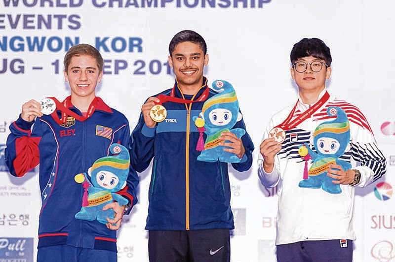 CHANGWON - SEPTEMBER 13: (L-R) Silver medalist Henry Turner LEVERETT of the United States of America, Gold medalist Udhayveer SIDHU of India and Bronze medalist Jaekyoon LEE of the Republic of Korea pose with their medals after the 25m Pistol Men Junior Event at the Changwon International Shooting Range during Day 12 of the 52nd ISSF World Championship All Events on September 13, 2018 in Changwon, Republic of Korea. (Photo by ISSF Photographers)