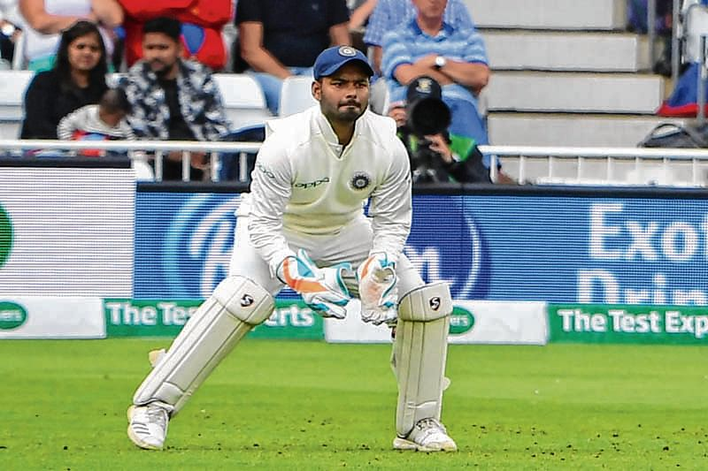 India's wicketkeeper Rishabh Pant, who's taken five catches on his test debut, keeping wicket during play on the second day of the third Test cricket match between England and India at Trent Bridge in Nottingham, central England on August 19, 2018. (Photo by Paul ELLIS / AFP) / RESTRICTED TO EDITORIAL USE. NO ASSOCIATION WITH DIRECT COMPETITOR OF SPONSOR, PARTNER, OR SUPPLIER OF THE ECB