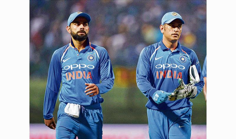 Kandy: India's Virat Kohli and Mahendra Singh Dhoni walk off the field after the Sri Lankan innings during the second ODI match at Pallekele International Cricket Stadium in Kandy on Thursday. PTI Photo by Manvender Vashist (PTI8_24_2017_000182B)