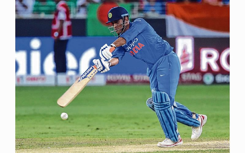 Indian batsman Mahendra Singh Dhoni plays a shot during the final one day international (ODI) Asia Cup cricket match between Bangladesh and India at the Dubai International Cricket Stadium in Dubai on September 28, 2018. (Photo by ISHARA S.  KODIKARA / AFP)