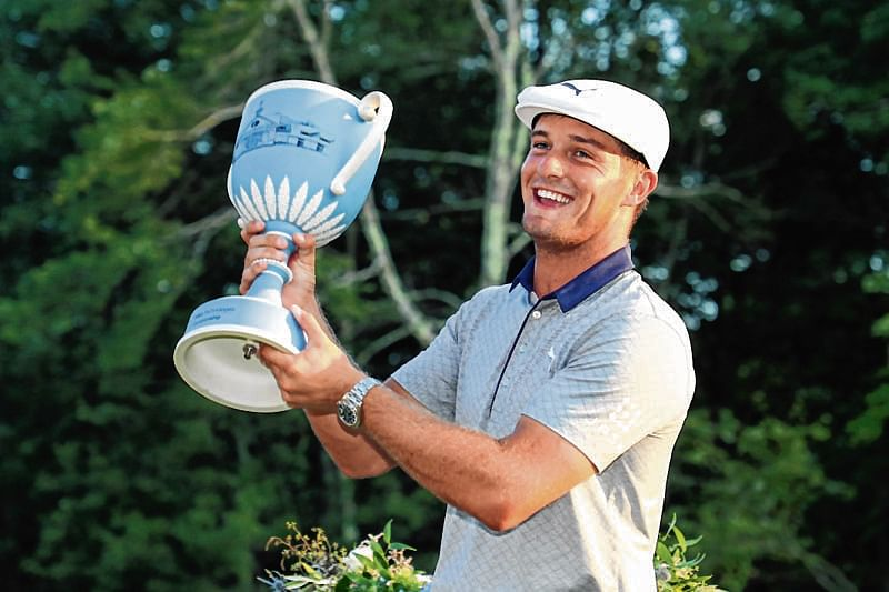 NORTON, MA - SEPTEMBER 03: Bryson DeChambeau of the United States poses with the trophy after winning the Dell Technologies Championship at TPC Boston on September 3, 2018 in Norton, Massachusetts.   Patrick Smith/Getty Images/AFP == FOR NEWSPAPERS, INTERNET, TELCOS & TELEVISION USE ONLY ==