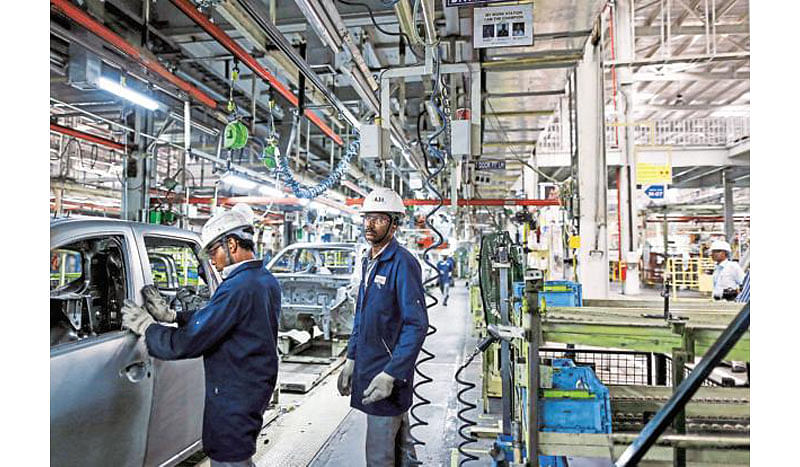 Factory activity hits  slow lane in Aug on weak demand