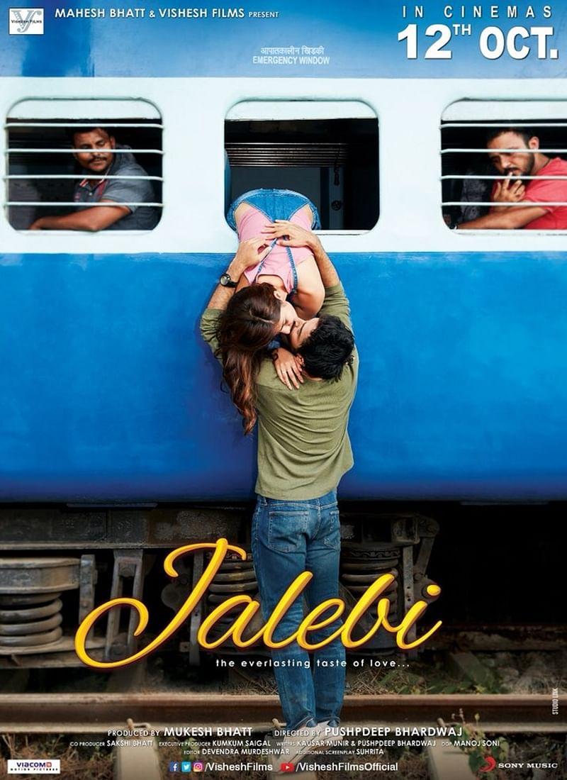 Jalebi Poster: Varun Mitra and Rhea Chakraborty indulge in bold train kiss