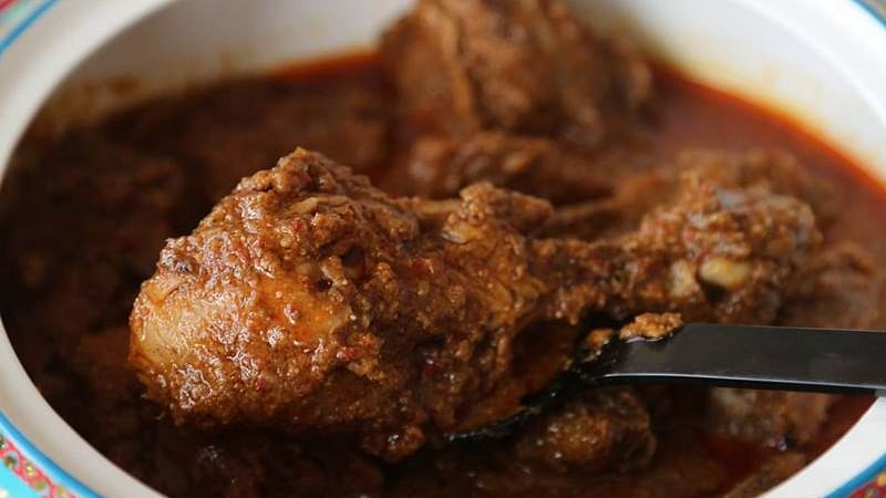 Officer suspended for eating chicken curry during school visit