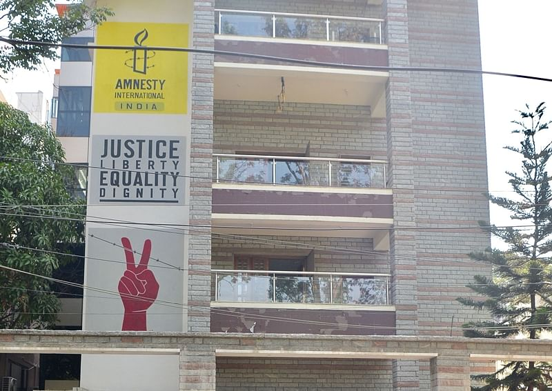 Amnesty International India 'halts work on upholding human rights' after GOI freezes its bank accounts