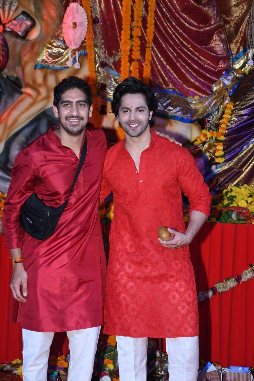 Varun Dhawan with Ayan Mukerji at Durga pandal. Photo by Viral Bhayani