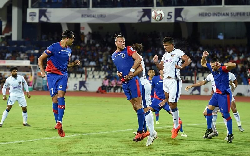Bengaluru:  Bengaluru FC's Nicolas Ladislao with Paartalu head kick with Chennaiyin Fc's Sabia Filho during the ISL 2018 at Kanteerava stadium in Bengaluru, Sunday, Sept 30, 2018. (PTI Photo/Shailendra Bhojak)
