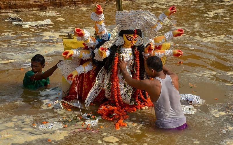 In pictures: Devotees bid teary farewell to goddess Durga and her children on 'Bijoya Dahasmi'