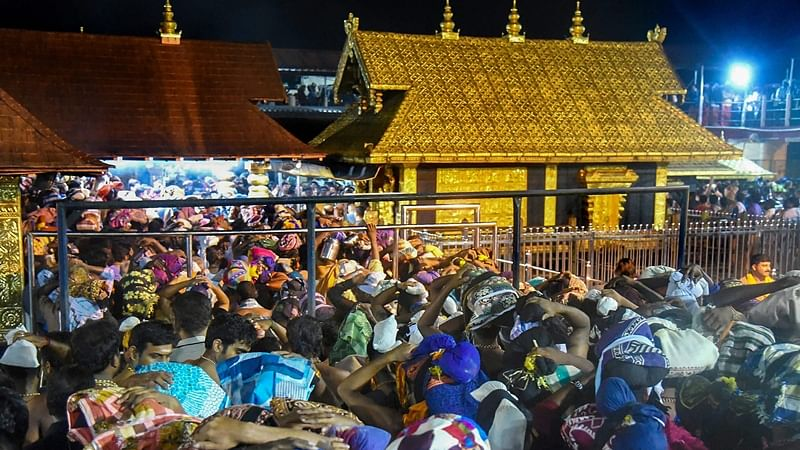 Devotees arrive to pay obeisance at Lord Ayyappa Temple in Sabarimala.
