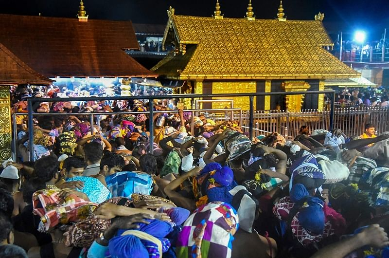 Devotees arrive to pay obeisance at Lord Ayyappa Temple in Sabarimala. PTI Photo