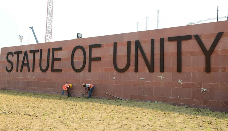 Indian workers give the finishing touches to a large sign for the world's tallest statue dedicated to Indian independence leader Sardar Vallabhbhai Patel. Photo by SAM PANTHAKY / AFP