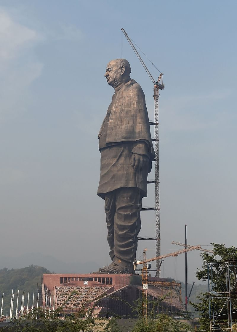 Indian workers give the finishing touches to the world's tallest statue dedicated to Indian independence leader Sardar Vallabhbhai Patel, overlooking the Sardar Sarovar Dam near Vadodara in India's western Gujarat state. Photo by SAM PANTHAKY / AFP