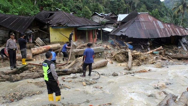 Indonesia floods: 27 dead in landslides