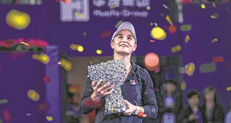 Ashleigh Barty of Australia holds the trophy after winning the women's singles final match against Wang Qiang of China at the Zhuhai Elite Trophy tennis tournament in Zhuhai, in south China's Guangdong province on November 4, 2018. (Photo by STR / AFP) / China OUT