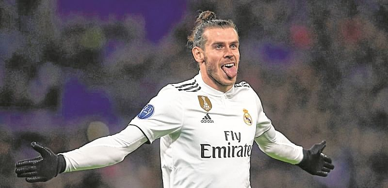 Real ride on Gareth Bale's strike to top group