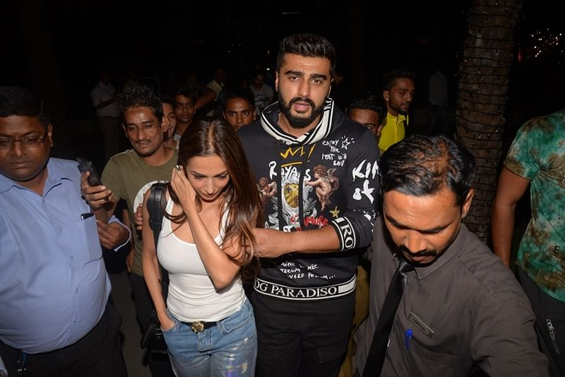 In Pictures! Arjun Kapoor protects ladylove Malaika Arora from fan frenzy