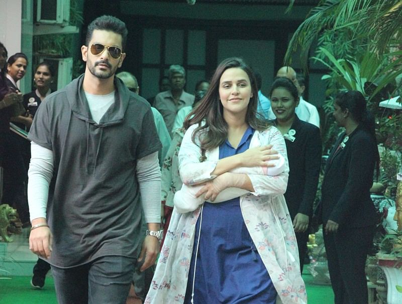 In Pictures: Neha Dhupia, Angad Bedi pose with daughter Mehr after getting discharge from hospital