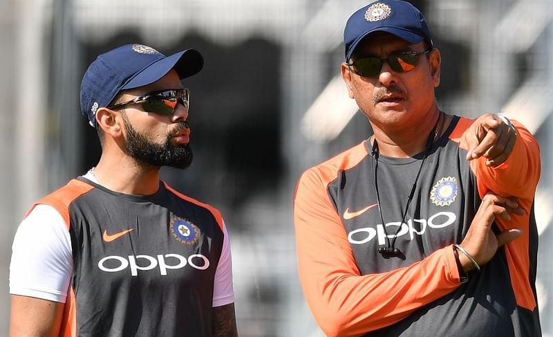 Virat Kohli with Ravi Shastri. File Pic/ AFP