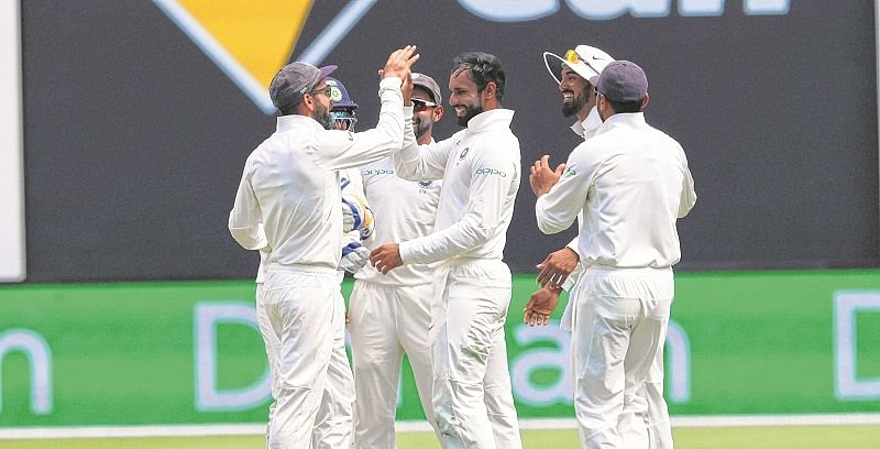 Perth: India's Hanuma Vihari, center, celebrates with teammates after claiming the wicket of Australia's Marcus Harris during the second cricket test in Perth, Australia, Friday, Dec. 14, 2018. AP/PTI(AP12_14_2018_000027B)
