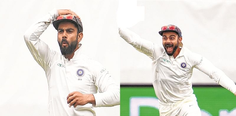 India's Virat Kohli (R) and teammate Rishabh Pant (L) celebrate the dismissal of Australian batsman Travis Head on the third day of the second cricket Test match in Perth on December 16, 2018. (Photo by WILLIAM WEST / AFP) / --IMAGE RESTRICTED TO EDITORIAL USE - STRICTLY NO COMMERCIAL USE--