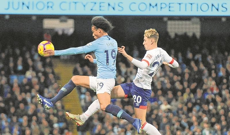 City withstand late Watford onslaught