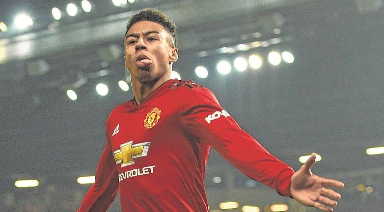 Manchester United's English midfielder Jesse Lingard celebrates scoring their second goal to equalise 2-2 during the English Premier League football match between Manchester United and Arsenal at Old Trafford in Manchester, north west England, on December 5, 2018. (Photo by Oli SCARFF / AFP) / RESTRICTED TO EDITORIAL USE. No use with unauthorized audio, video, data, fixture lists, club/league logos or 'live' services. Online in-match use limited to 120 images. An additional 40 images may be used in extra time. No video emulation. Social media in-match use limited to 120 images. An additional 40 images may be used in extra time. No use in betting publications, games or single club/league/player publications. /