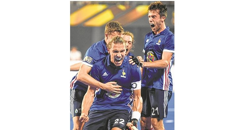 France's Victor Charlet with teammates celebrate after scoring a goal against Argentina during the field hockey group stage match between France and Argentina at the 2018 Hockey World Cup in Bhubaneswar on December 6, 2018. (Photo by Dibyangshu SARKAR / AFP)