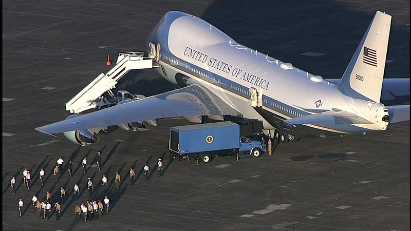 Air Force One arrives in Houston to carry George H W Bush casket to Washington