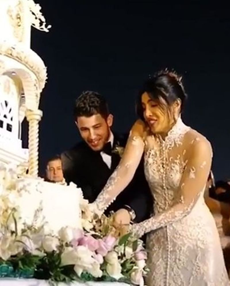 This is Sparta! Priyanka-Nick slice off their luxurious 18-feet tall, 6-tier cake with a sword