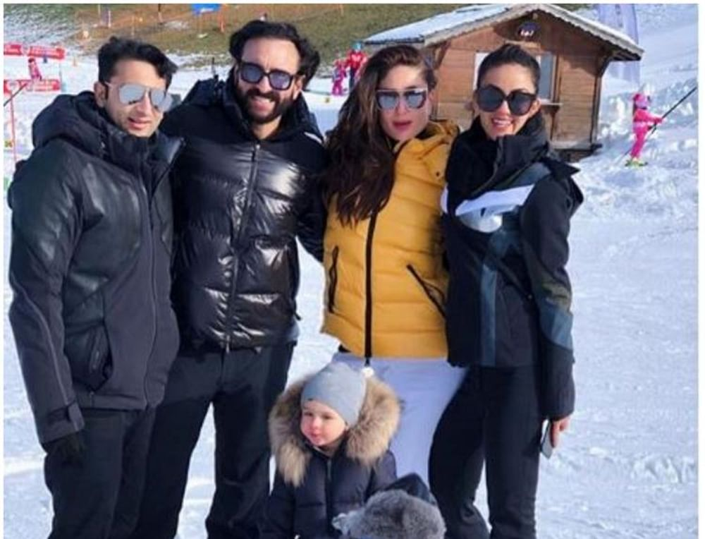 Taimur's unfazed look is the highlight of this pic featuring Kareena, Saif and their friends at Swiss vacay