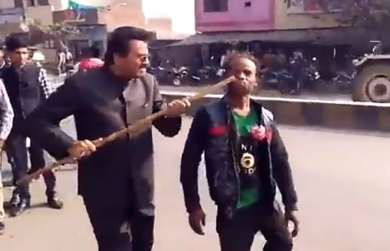 Watch Video: BJP leader hits differently-abled man with stick for backing Samajwadi Party