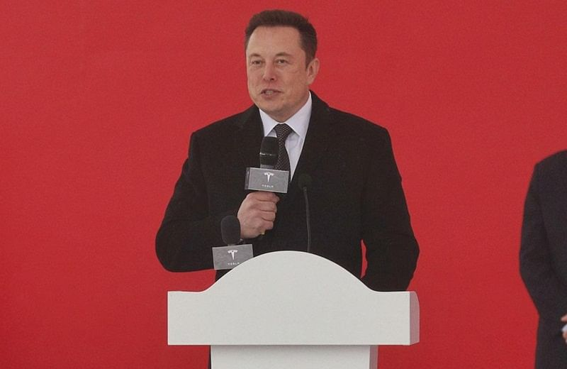 "Tesla boss Elon Musk speaks during the ground-breaking ceremony for a Tesla factory in Shanghai on January 7, 2019. - Musk presided over the ground-breaking for a Shanghai factory that will allow the electric-car manufacturer to dodge the China-US tariff crossfire and sell directly to the world's biggest market for ""green"" vehicles. (Photo by STR / AFP) / China OUT"