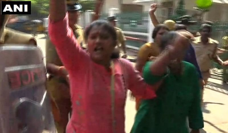 Sabarimala temple: BJP protest against two women entering shrine, wave black flags at two ministers