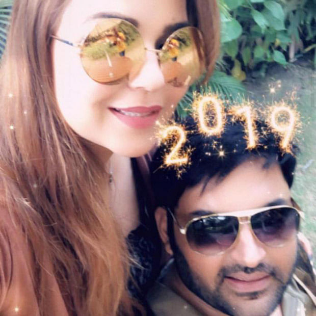 Newlyweds Kapil Sharma and Ginni Chatrath strike a lovey dovey pose, usher in New Year